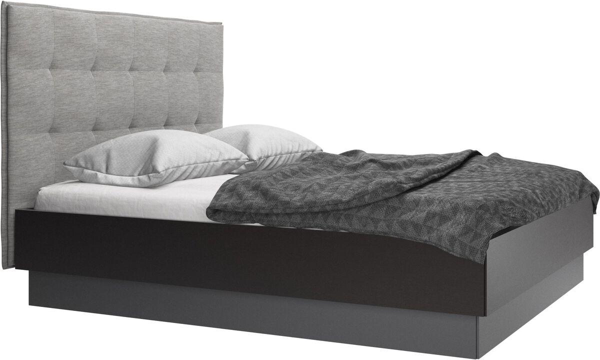Betten - Lugano Bett mit Lattenrost und Staufach unter hochklappbarer Liegefläche, Matratze gegen Aufpreis - Grau - Stoff